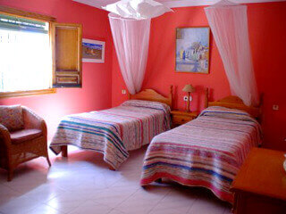 photo of one of the red bedrooms of the finca